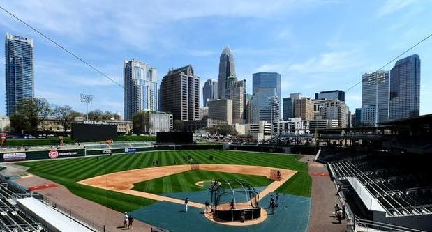 The trend to head downtown continues as the beautiful Charlotte skyline towers over new BB&T Ballpark (image from The State)